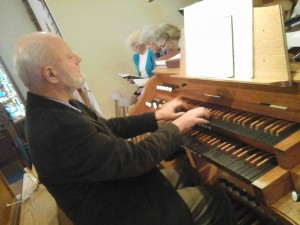 Organist John Atwood at the console during choir rehearsal.