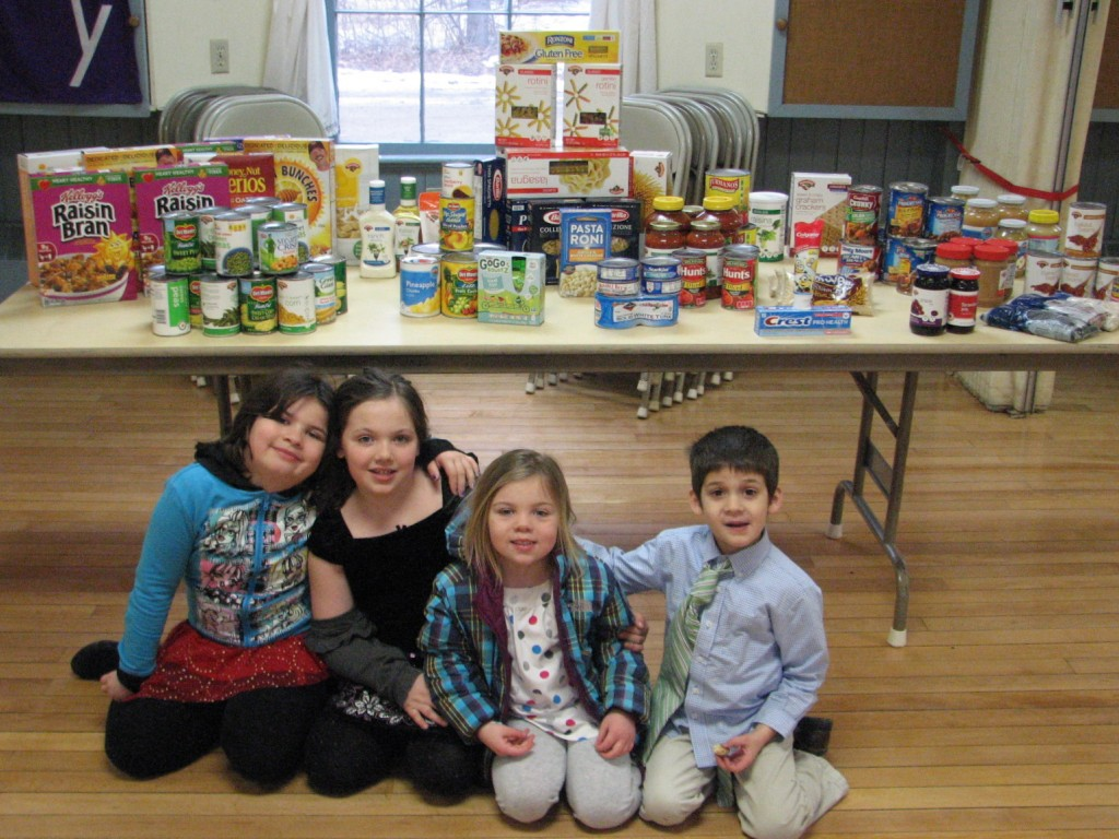 The children raised money and used it to shop for food shelf donations.