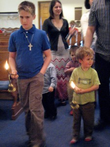 Shane & Micah lighting the candles